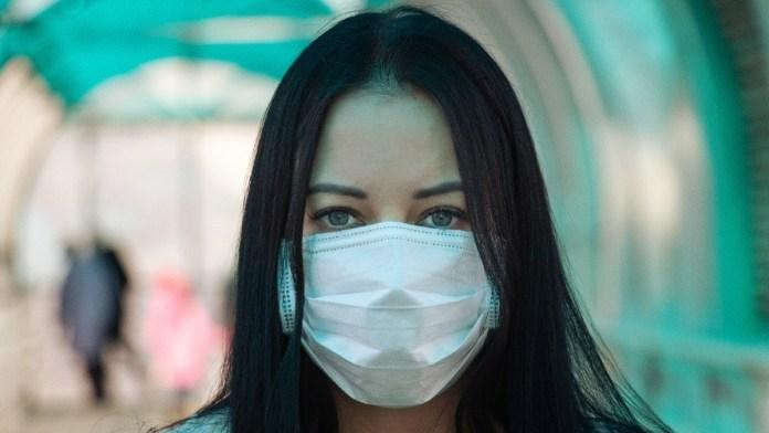 Girl using mask to avoid Coronavirus