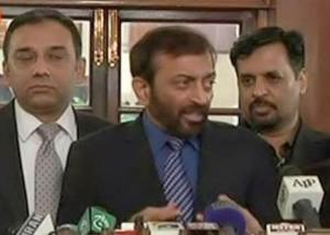 Dr Farooq Sattar is talking to media along with Raza Haroon and Mustafa Kamal