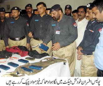 CCPO and other officers inspecting weapons recovered from the accused