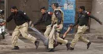 Cops are rescuing a citizen after clash PAT workers in Modeltown ,Lahore