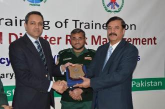 DG Rescue Punjab gives sheild to Brig. (R) Sajid Naeem, while Dr. Farhan Khalid is also seen (1)