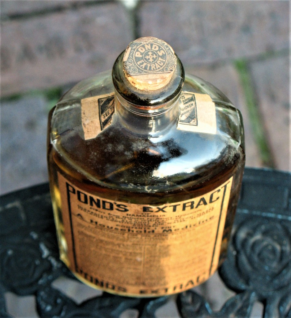 Bottle of Pond's Extract, a medicine made of witch-hazel extract.