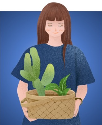 Woman holding plants in basket