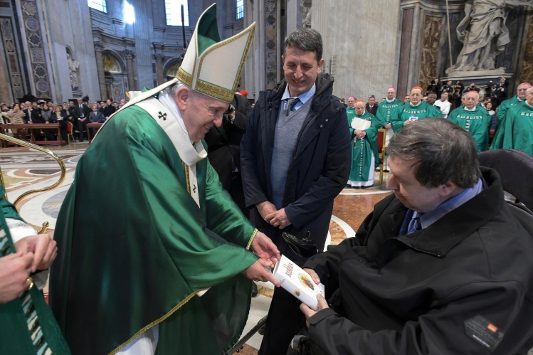 pope francis giving bible