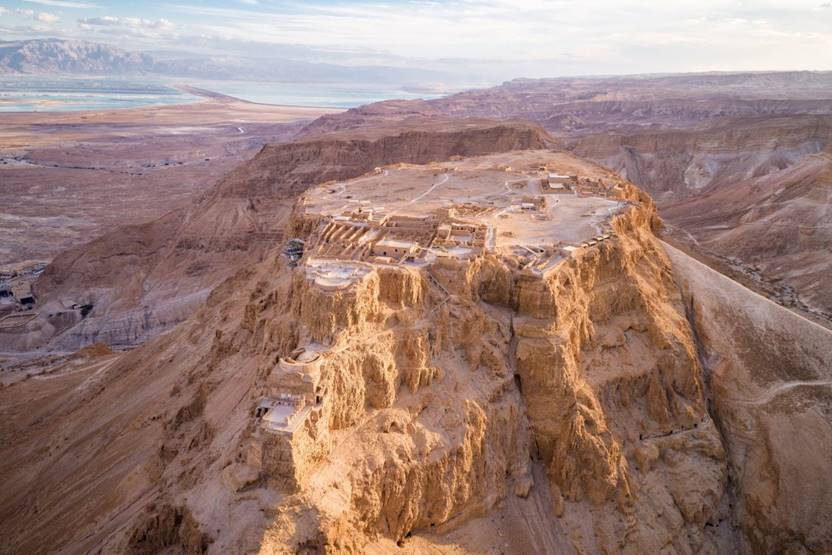 Masada is an ancient fortress in southern Israel's Judean Desert. It's on a massive plateau overlooking the Dead Sea. A cable car and a long, winding path climb up to the fortifications, built around 30 B.C. Among the ruins are King Herod's Palace, which sprawls over 3 rock terraces, and a Roman-style bathhouse with mosaic floors.
