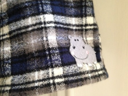 Little hippo detail on flannel shorts