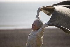 senior-woman-standing-blanket