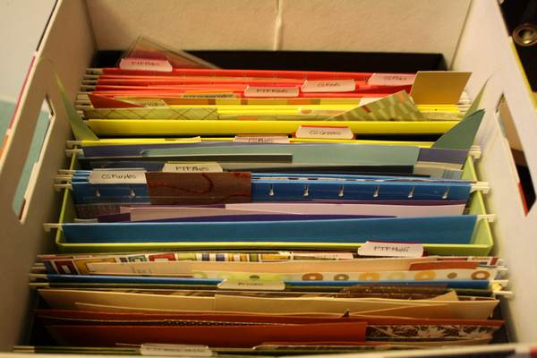 Paper scraps organized by color/type