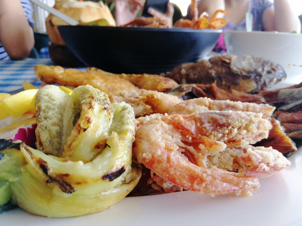 photo of a platter of fried food including shrimp, cooked eggplant, fish at patio del sol seafood restaurant