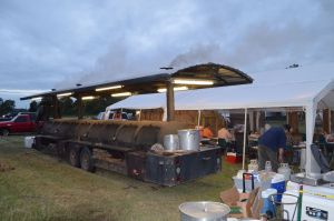 Barbecue smoker preparing food the night before the event.
