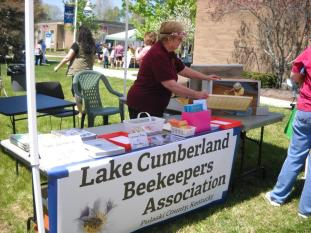 Pat Rizenbergs welcomes visitors to the LCBA display table