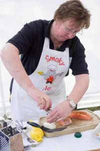 Jo Hampson of Smoky Jo's, demonstrating how to prepare salmon prior to smoking