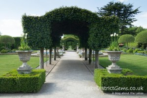 The Portuguese Laurel arches in the Summer Garden at Holker Hall