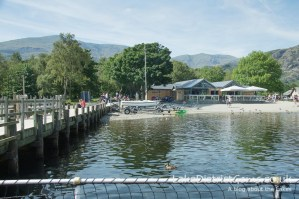 Coniston Pier with the Bluebird Café in the background