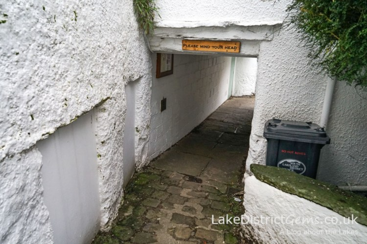 An archway under the cottages