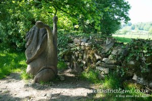 A wooden snail sculpture at Sizergh Castle