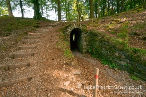 You'll find this intriguing little viewing tunnel in the grounds of which Lake District property?