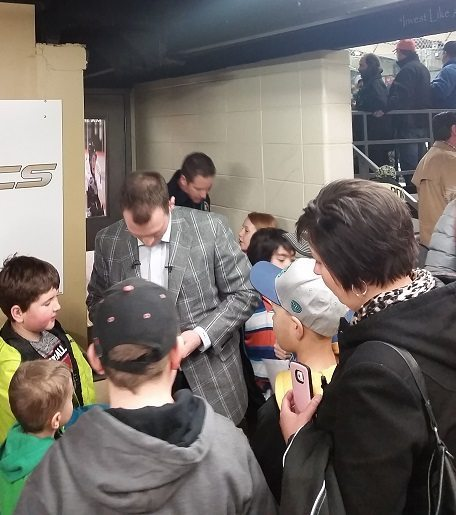 Letestu signed every piece of memorabilia and took time to pose for pictures with each kid