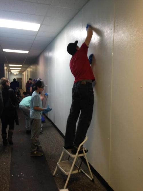 Midget team working on washing walls