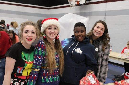 Happy BCHS Students help with the wrapping party