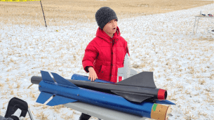 Seven-year-old Connor McCaffrey checking out the rocketry equipent.