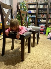 She's mastered climbing over the chairs, but climbing from chair to chair is still a challenge, and the challenge is what makes obstacle course fun!