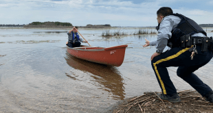 Joint effort saves stranded rafter from island on Jessie Lake