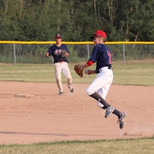 Kobe Warawa throwing to first for an out