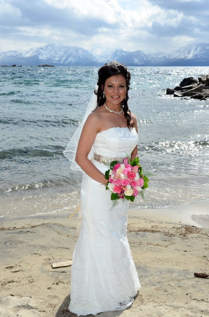 bride white dress pink bouquet on beach