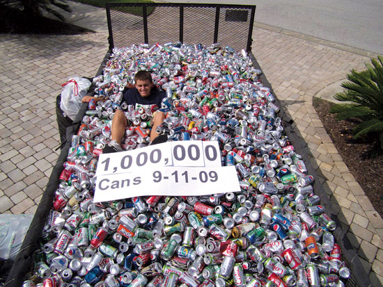 Matt Mooney, 16, a resident of Dade City and an 11th-grader in the International Baccalaureate program at Land O' Lakes High, is surrounded by some of the 1,000,000 aluminum cans he collected between 2006 and Sept. 11 of this year. Matt's goal is to use the proceeds from enough recycled cans to build an entire house for East Pasco Habitat for Humanity. Special to The Laker/Lutz News.