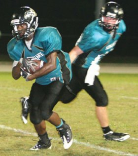 Quarterback Jacob Jackson, throwing a pass to teammate Leeroy Thompson in a game against Wesley Chapel, took great pleasure in leading Sunlake to an upset win over Gulf, his former team. Photo by Anthony Masella Jr., www.OurTownFLA.com.