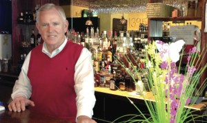 Chuck Eade, new owner of Jan's Wine & Boos at W. Lutz Lake Fern Road.