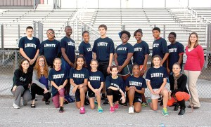 Under first-year coach Toni Kuzmicki, far right, Liberty Middle School's track team sent 17 athletes to the county championship. (Courtesy of Liberty Middle School)
