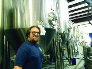 Mike Bishop, co-founder and head brewer at Big Storm Brewing Co., displays some of the tanks used in producing four different brews of Big Storm beer from his Odessa location.  (Michael Hinman/Staff Photo)