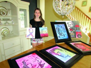 Izzie Brown, 14, creates portraits of famous personalities using words or, in the case of Albert Einstein, numbers. She also creates commissioned works, including this surrealistic piece called 'Consummation.' (B.C. Manion/Staff Photo)