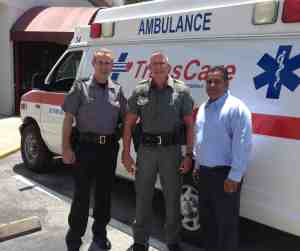 TransCare is donating two ambulances to Guyana in South America thanks to the help of efforts like, from left, Pasco County Sheriff's Office major John Corbin, Sgt. Mike Mielke, and TransCare vice president Terence Ramotar. (Courtesy of Crisis Center of Tampa Bay)