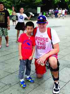 Darin Kilfoyl poses with a young boy from China during Kilfoyl's two-week trip to learn more about the country's language, culture and history. It turns out that much of the clothing worn by the people he encountered is similar to the clothing that Americans wear, he says. (Courtesy of Darin Kilfoyl)