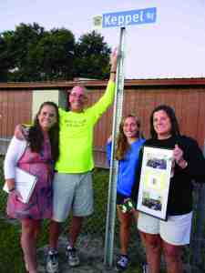 Kris Keppel along with daughters Meredith and Morgan, and wife Dar, proudly show the new sign students and visitors will see leading the way to the athletic fields of Land O' Lakes High School. Principal Ric Mellin says this will remind everyone to take the 'Keppel way.' (Michael Hinman/Staff Photo)