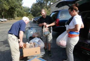 Mark Van Trees, left, Steve Dieulio and teacher Colleen McCormick load up more than 320 pounds of candy donated by Academy at the Lakes. The school donates leftover sweets to Support the Troops each year. (Michael Murillo/Staff photo)