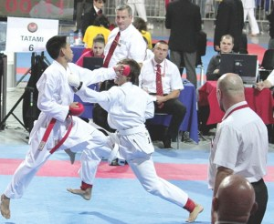 Derick Vo, left, battles an opponent from Portugal at the karate championship in Poland. His performance helped him earn bronze in the. (Courtesy of Duy-Linh Vo)