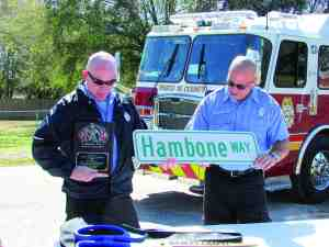 William 'Hambone' Hammond has a street named in his honor in Wesley Chapel, a community the firefighter has served for about 15 years. Hammond accepted the honor with humility, thanking countless people in the crowd for helping him along the way. (B.C. Manion/Staff Photo)