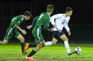 Wiregrass Ranch High School junior Brendan Duran races past Melbourne players during the regional final. Duran scored the game's only goal to lift Wiregrass Ranch to its first state tournament. (Fred Bellet/Photo)
