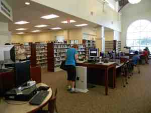 An arched window and high ceiling allows for natural lighting to give the new library in Zephyrhills something of a Barnes & Noble feel. (Kathy Steele/Staff Photo)