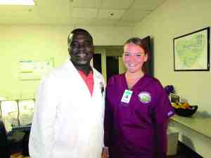Greg Mathis, program director for the B.E.S.T. Academy Camp Program at Florida Hospital Zephyrhills, poses with student Emily Daffron, one of 20 students taking part in the academy. (B.C. Manion/Staff Photos)