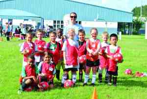 Grace Community Church is hosting another youth soccer camp on Sunday mornings in August. Last year's group of youngsters learned about faith and the finer points of soccer.  (Courtesy of Jeff Olsen)
