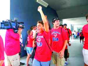 About 40 friends, family members and school faculty members waved flags and cheered as the Land O' Lakes High School Special Olympics Unified Soccer team headed to the airport on the first leg of their trip to Los Angeles.