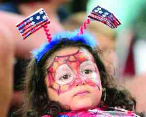 Four-year-old Noor Keraa wore her patriotic headdress as she watches the contestants of the Little Miss Firecracker pageant during the Wesley Chapel Freedom Fest at The Shops at Wiregrass. She was at the Independence Day event with her dad, Sami Keraa of Wesley Chapel.
