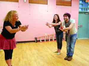 Choreographer Julie Nelson, left, works with the stars of 'Mary Poppins.' Courteney McClutchy (Mary) and Jarrett Koski (Bert) prepare for opening night on Aug. 7. (Michael Murillo/Staff Photos)