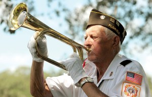 VFW Post 8154 Honor Guard bugler Jerry Morel, 82, sounds taps during Zephyrhills' 'We Remember: 9/11 Memorial Service.'