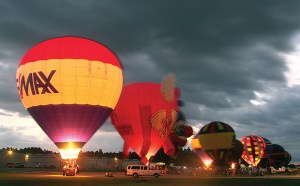 Inflated hot air balloons create a colorful spectacle during the balloon glow at last year's Festival of Flight. (File Photos)